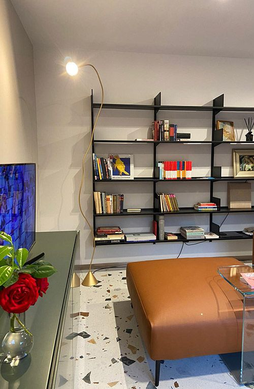 Continua bookcase, Papiro and Alexandra lamps in private residence